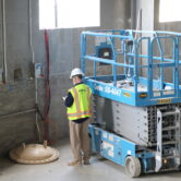 Mbroh Worker with Scissorlift
