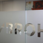 Mbroh Logo on Glass